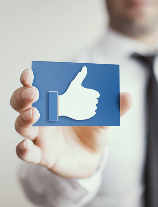 Person holding Facebook Like icon