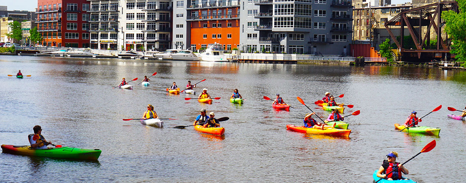 People kayaking on the Milwaukee River